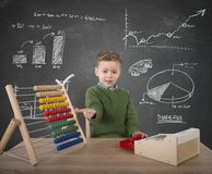 Child plays with money. Child plays to make calculations with money Stock Photo