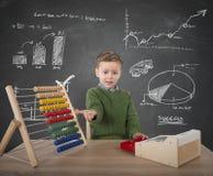 Child plays with money stock photo