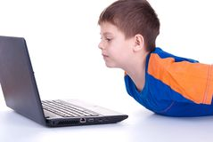 A child plays with a notebook Royalty Free Stock Photo