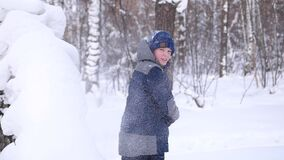 A child plays in the open air in winter, throws snow. Active outdoor sports. stock footage