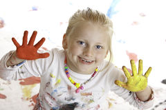 Child plays painter and smiles happy Royalty Free Stock Image