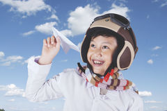 Child plays a paper plane Royalty Free Stock Image