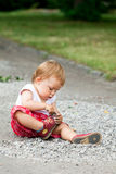 Child plays with pebbles Royalty Free Stock Image