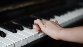 Child plays the piano. stock video footage