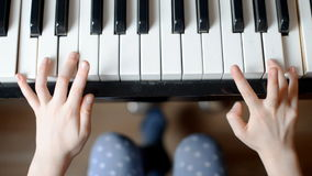 Child plays the piano. stock footage