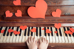 Child plays on a piano royalty free stock image