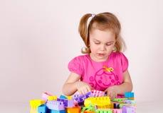 Child plays in the plastic designer. stock images
