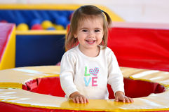 Child Plays in Play Center. A girl toddler plays in an indoor play center Stock Photos
