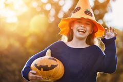Child plays with pumpkin Stock Photos