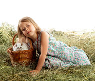 The child plays with the rabbit Stock Images