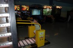 A child plays in a room with slot machines stock image