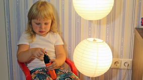 Child plays with a screwdriver stock video footage