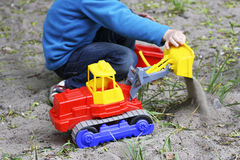 A child plays with a shovel.. Royalty Free Stock Photos