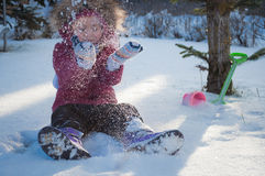 A child plays in the snow. A child plays and throws snow over the head stock images