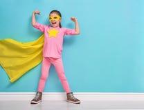 Child plays superhero stock photography