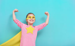 Child plays superhero royalty free stock image