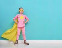 Child plays superhero royalty free stock photo