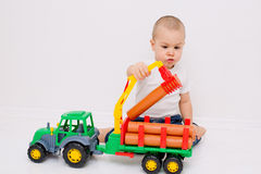 Child plays with a timber truck Stock Photo