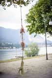 Little girl climbs on a big rope in the outdoor Royalty Free Stock Photos