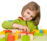 Child plays with toy blocks Royalty Free Stock Photos