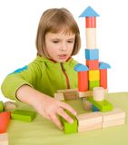 Child plays with toy blocks Stock Images