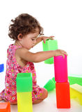 Child plays with toy blocks Stock Photography