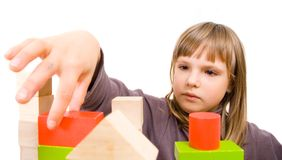 Child plays with toy blocks Royalty Free Stock Photography
