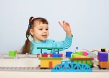 Child plays with a toy railroad Royalty Free Stock Image