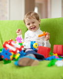 Child plays with toys in home Royalty Free Stock Image