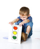 Child plays with traffic signs Royalty Free Stock Images
