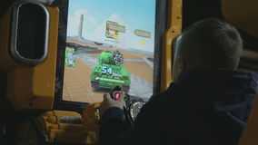 The child plays in a video game-tank