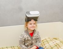 The child at home with virtual reality glasses. The child plays with VR glasses Stock Images