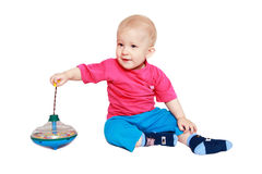 Child plays with whirligig. Kid with developing toy- whirligig Royalty Free Stock Photo