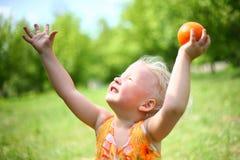 Child Plays With Orange