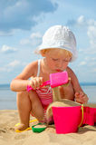 Child Plays With Toy In Sand Stock Images