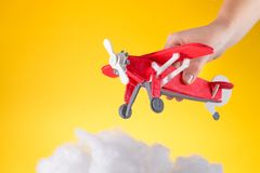A child plays with wooden toy plane royalty free stock photography