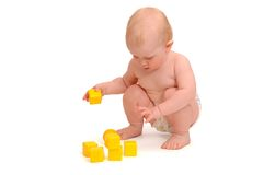 Child plays yellow cubes Stock Photography