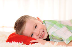 Child with a plush heart Stock Image