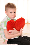 Child with a plush heart Royalty Free Stock Photo