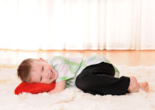 Child with a plush heart Royalty Free Stock Image