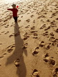 Child pointing. On beach with shadow royalty free stock photography