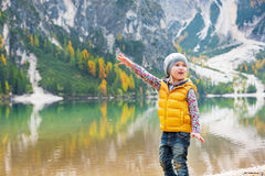 Child pointing on copy space while on lake braies Royalty Free Stock Photo