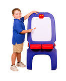 Child pointing at dry erase board. With room for your text royalty free stock photos
