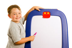Child pointing at dry erase board Royalty Free Stock Images