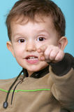 Child pointing finger at you. Little boy shows his index finger on you Stock Image