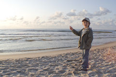 Child pointing out to sea Royalty Free Stock Photography