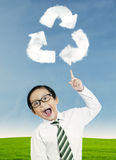 Child pointing at recycle symbol Royalty Free Stock Photography