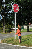 Child pointing to stop sign. Little child playing at a traffic playground, pointing to the stop sign Stock Photography
