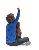 Child pointing at wall. Rear view. Stock Images