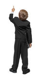Child  pointing at wall. Rear view. Royalty Free Stock Photos